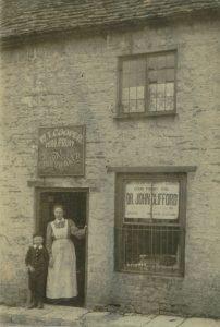 Mrs. Cooper outside shop in West End